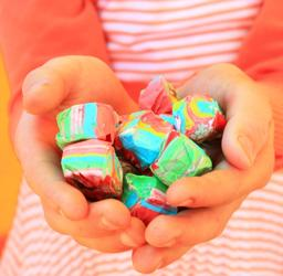 Photo of child holding candy by D Sharon Pruitt; see https://commons.wikimedia.org/wiki/File:Free_Child_Holding_Happy_Colorful_Rainbow_Taffy_Candy_(unedited)_Creative_Commons_(3354087435).jpg