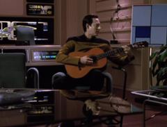 Data playing guitar