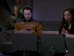 Data playing oboe